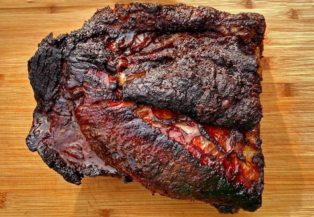juicy smoked beef brisket on cutting board
