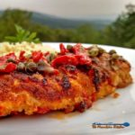 Sun-Dried Tomato Crusted Chicken is a delight! The breast are lightly battered in a sun-dried tomato crust, topped with a rich and tangy sunny butter sauce. | TheMountainKitchen.com