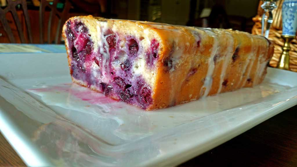 This Blueberry Lemon Yogurt Loaf captured that hot summer morning picking blueberries at my mama's house perfectly. This loaf has quite the zing to it and it is bursting with lemon flavor and fresh blueberries. It practically melts in your mouth and I am sure it would bring warm summer thoughts to your mind even in the dead of winter! | TheMountainKitchen.com