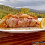 Easy baked Mahi Mahi is oven baked enclosed in a packet that locks in moisture and flavor cooked with potatoes, onions, lemon, slices and bacon.   TheMountainKitchen.com