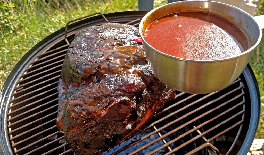 saucing BBQ Pork picnic shoulder