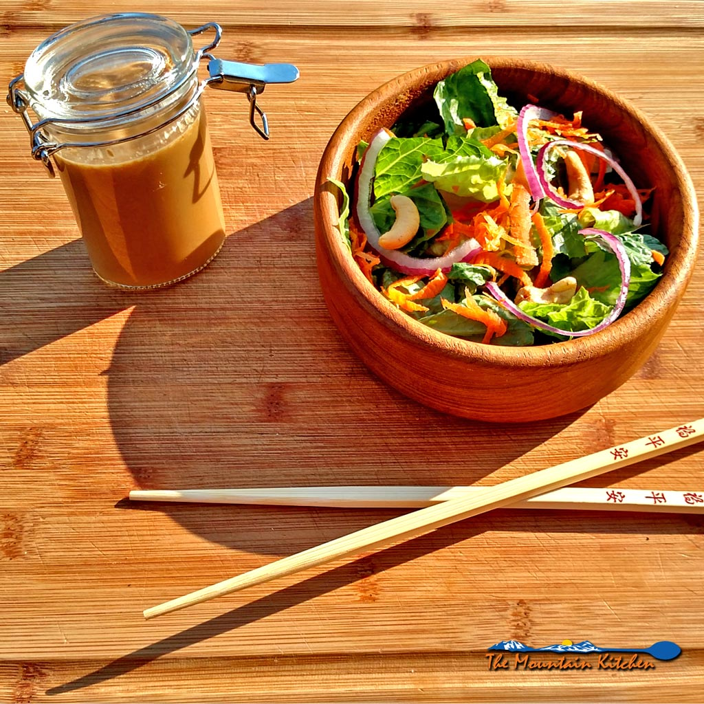 This Asian Salad with Sesame Dressing is sweet, savory, and slightly tangy, and has a definite sesame flavor that makes this dressing so good! | TheMountainKitchen.com