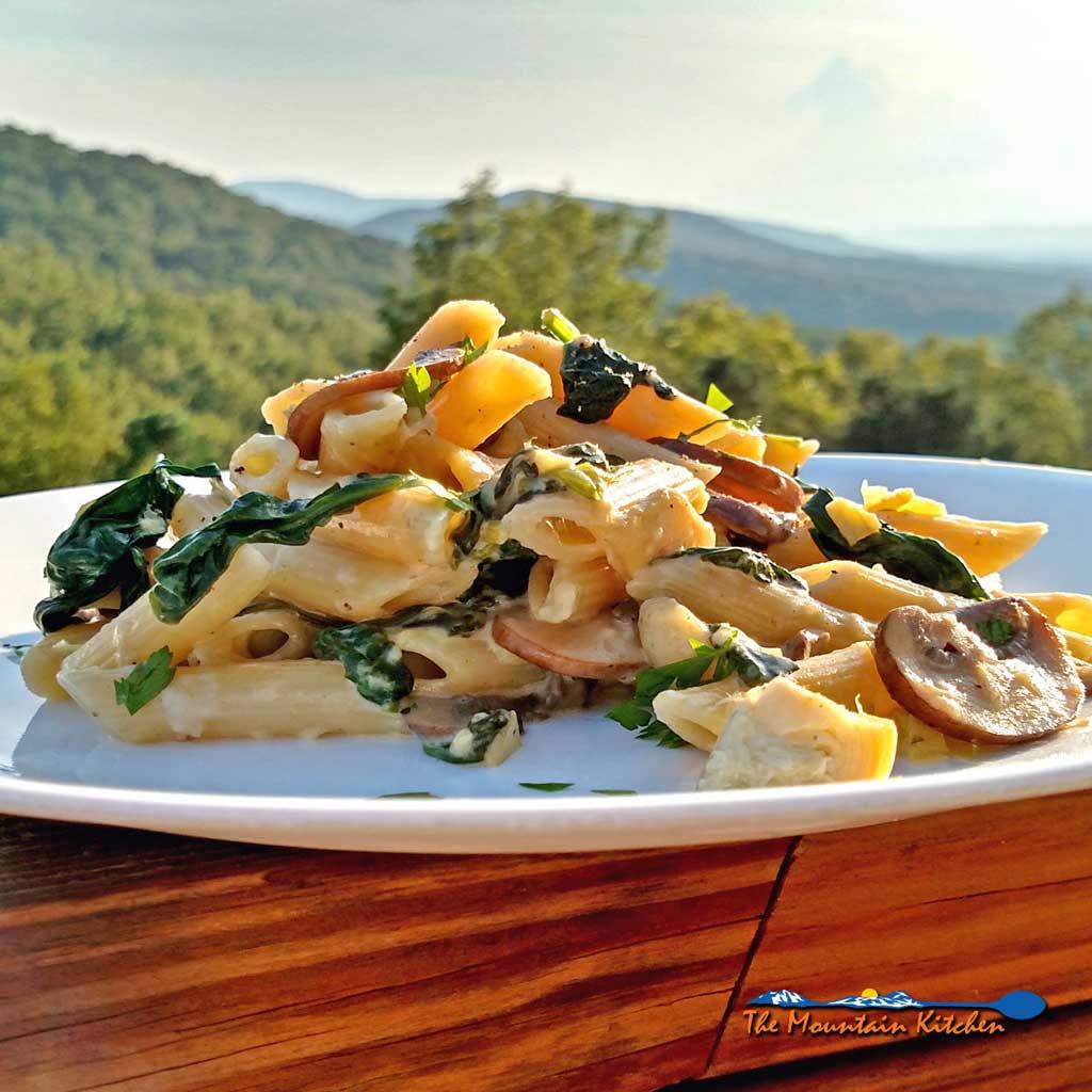 Mushroom Spinach Artichoke Alfredo Pasta is a delicious vegetarian pasta with hearty mushrooms, creamy spinach, and artichokes in Alfredo sauce. Amazing! | TheMountainKitchen.com