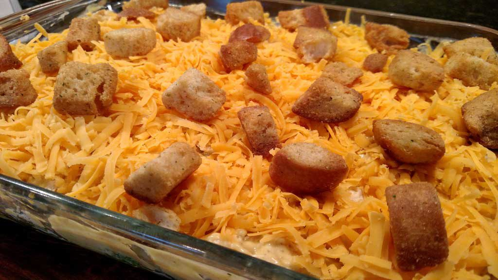 Curry Chicken broccoli casserole topped with a curry flavored sauce with lemon juice, topped with cheddar cheese and crunchy garlic flavored croutons. | TheMountainKitchen.com