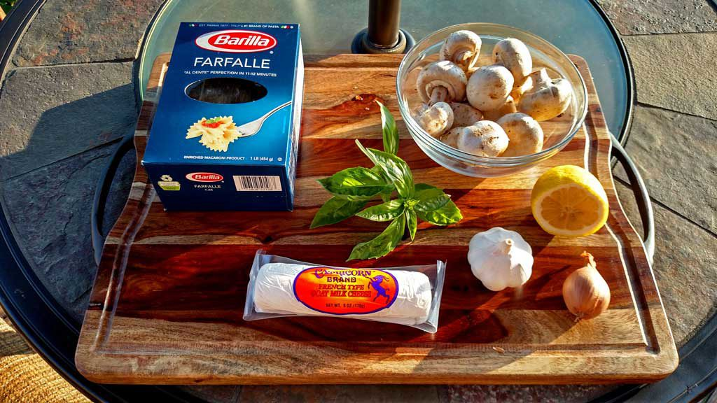 Ingredients to make Mushroom Goat Cheese Farfalle on cutting board