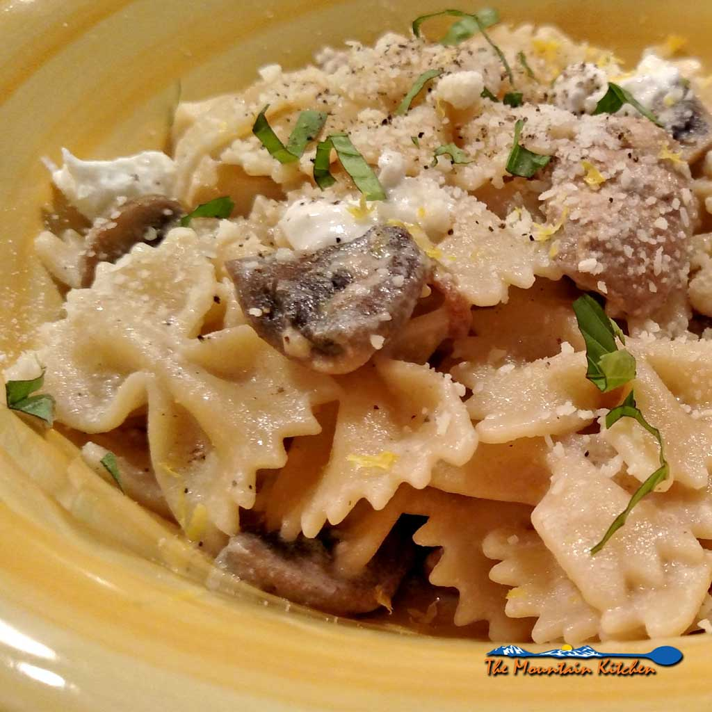 This delicious Mushroom Goat Cheese Farfalle pasta dish is loaded with mushrooms, garlic and shallots in creamy goat cheese sauce, with lemon and basil. | TheMountainKitchen.com