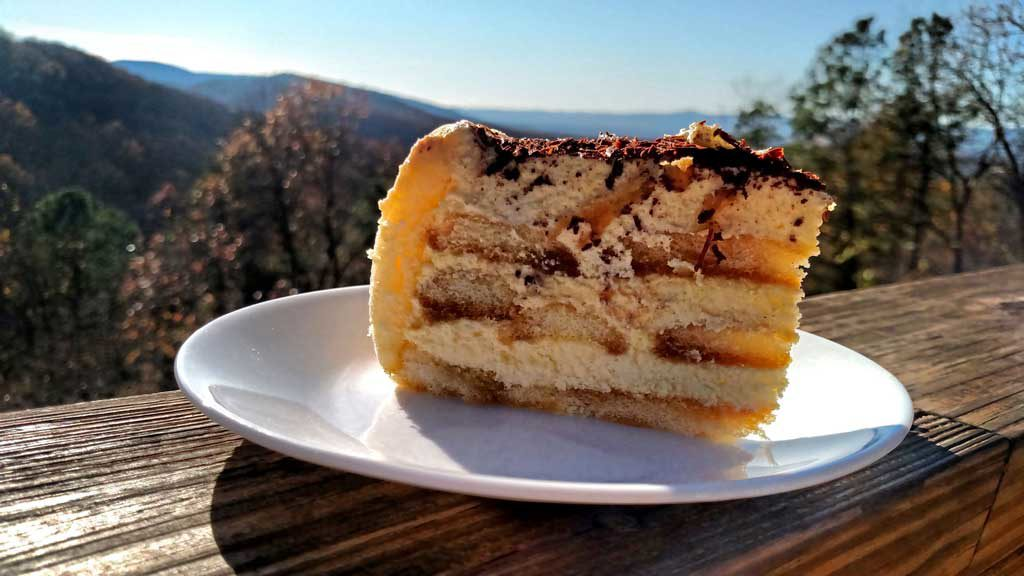slice of homemade tiramisu with mountain view