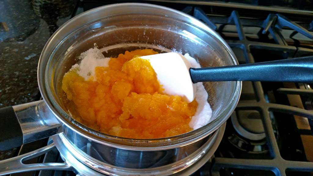 melting the sugar into egg yolks in double-boiler