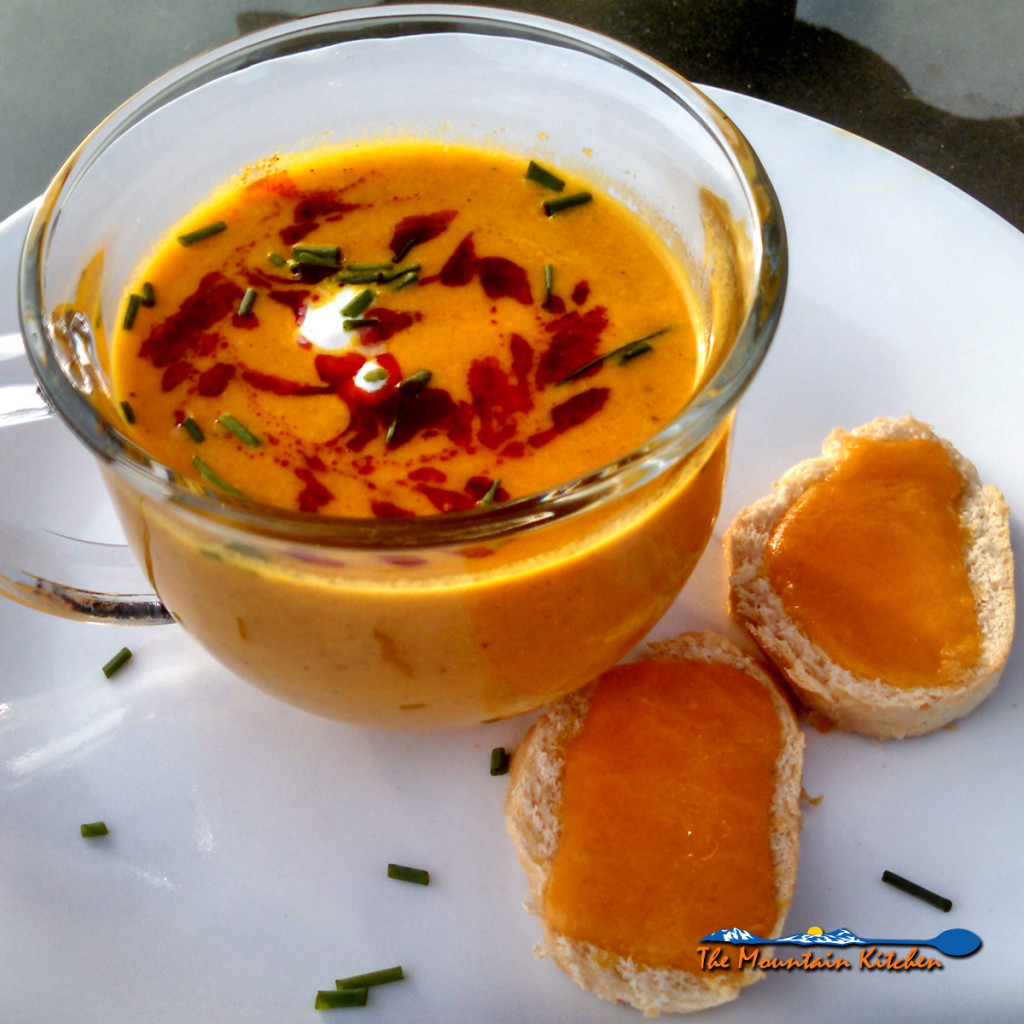 Roasted Carrot-Apple Soup is made with roasted carrots, onions, and apples blended until creamy and seasoned with garlic and fresh warm spices. Delightful! | TheMountainKitchen.com