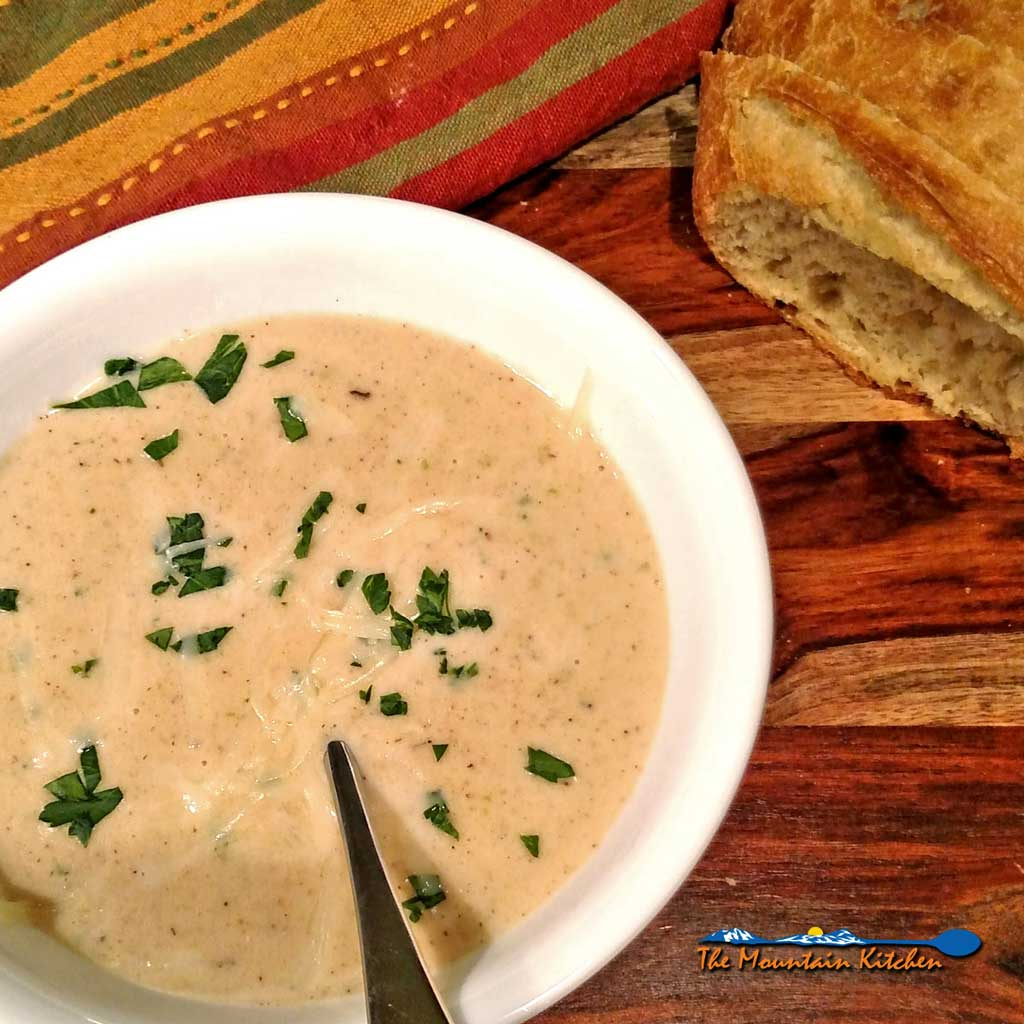This easy-to-make, roasted cauliflower white cheddar soup will become a winter favorite. It's creamy, thick and velvety and sure to warm up your bones on a cold winter day. | TheMountainKitchen.com