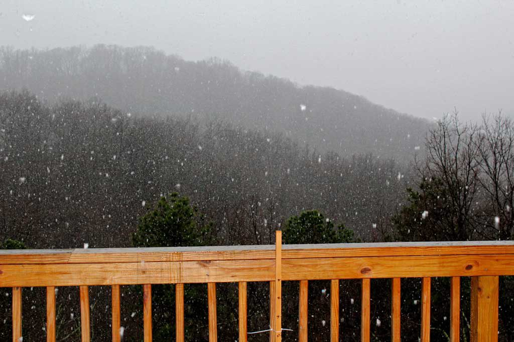 snow falling from deck