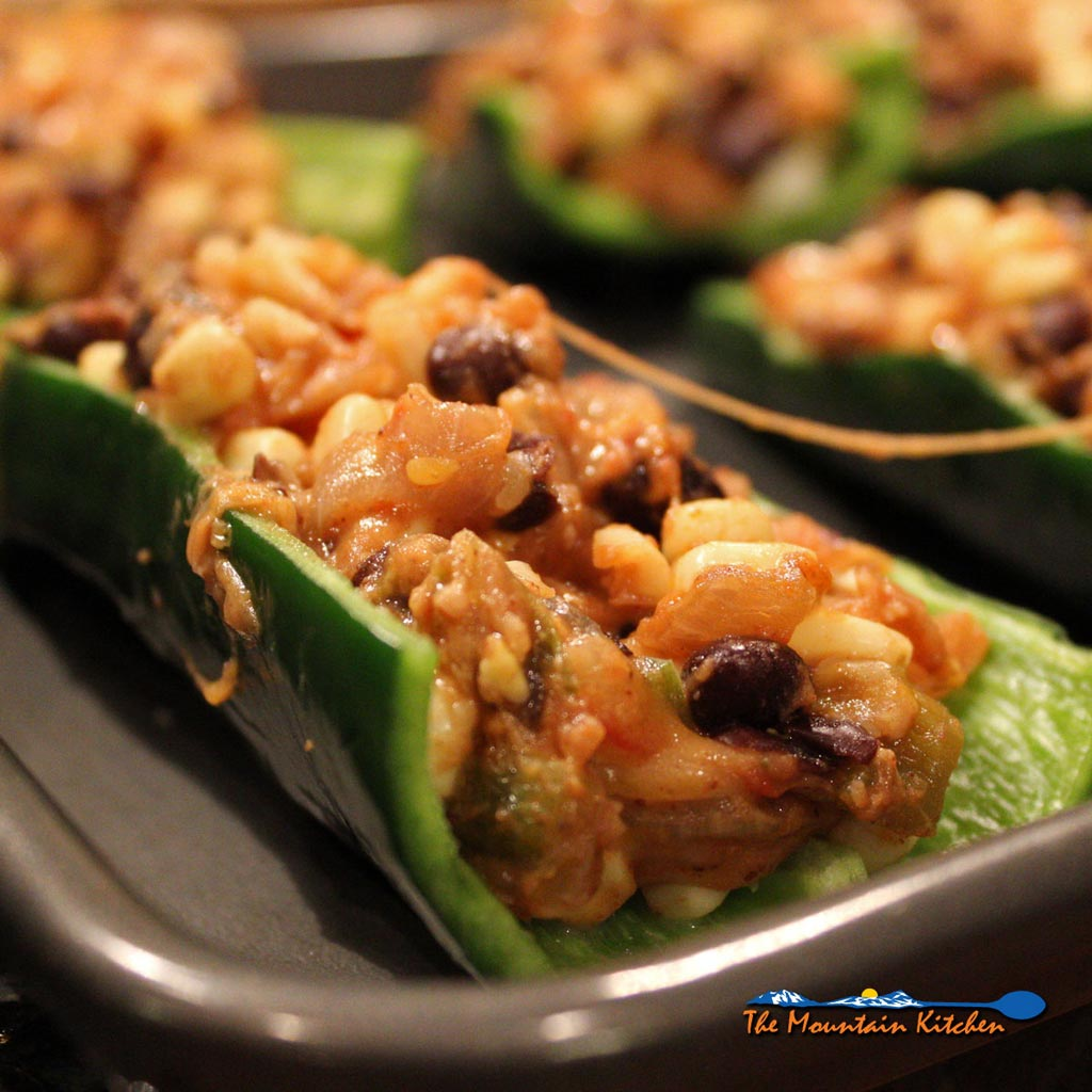 Stuffed poblano peppers stuffed with sweet pops of heat, sauteed onions, jalapenos, black beans, sweet corn, chunky salsa and cheese. | TheMountainKitchen.com