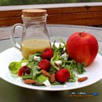 Cherry-Apple Salad With Orange Champagne Vinaigrette - Take a break from your usual salad with this refreshing and flavorful cherry-apple salad. This salad has different textures and crunch with a tangy and bright orange champagne vinaigrette and smooth creamy goat cheese, that will make your mouth happy! | TheMountainKitchen.com