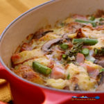 Savory Bread Pudding With Ham Asparagus and Mushrooms | This is a savory bread pudding loaded with smoked Virginia ham, fresh asparagus, portobello mushrooms, Gruyere cheese & croissants, soaked in rich custard. | TheMountainKitchen.com