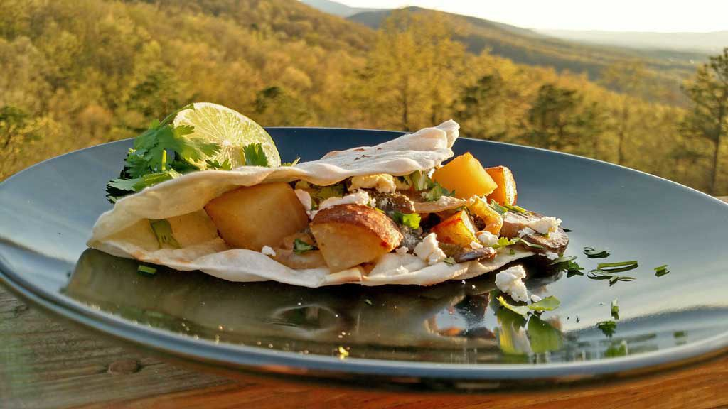 Tacos, filled with roasted poblano peppers, sauteed mushrooms and onions with country-style skillet potatoes served in a cream sauce with a hint of lime. | TheMountainKitchen.com