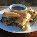 Dripping with goodness the beef for these Slow-Cooker French Dip Sandwiches is slow cooked for hours, served on toasted rolls with melted cheese and au jus.