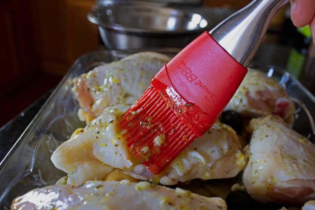 brushing chicken thighs with garlic mixture