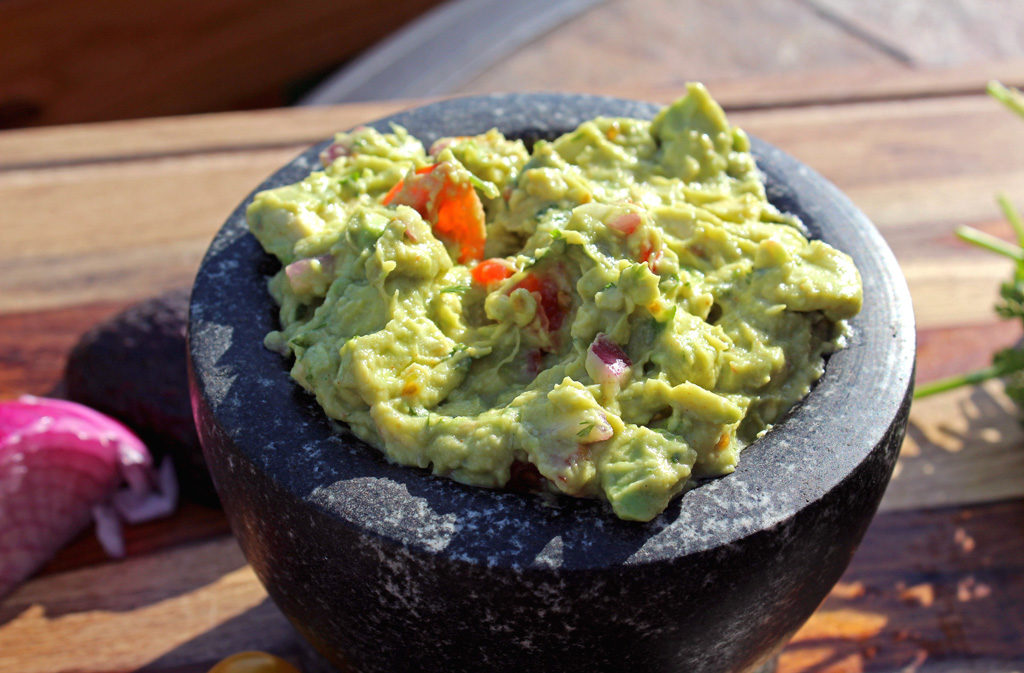 Guacamole | Get those chips ready for dipping! Served smooth or chunky, this guacamole gets added flavor from ground cumin and a little bit of heat from cayenne pepper. It's flavorful, clean and healthy. | TheMountainKitchen.com