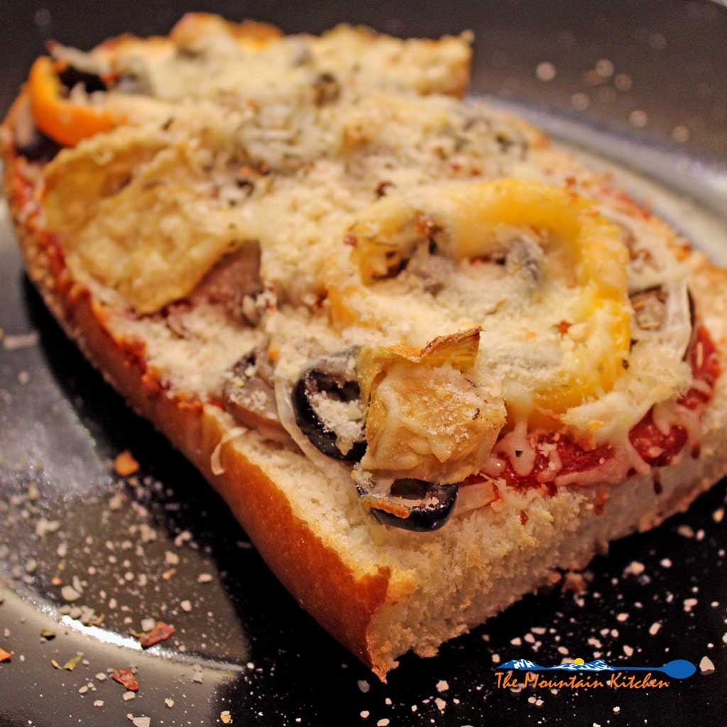 vegetable-french-bread-pizza-These french bread pizzas are crisp on the bottom and can be loaded with a variety of toppings of your choice. A great lunch or dinner idea in just minutes, that is easy to prepare and made to order by your family and friends in just minutes. | TheMountainKitchen.com