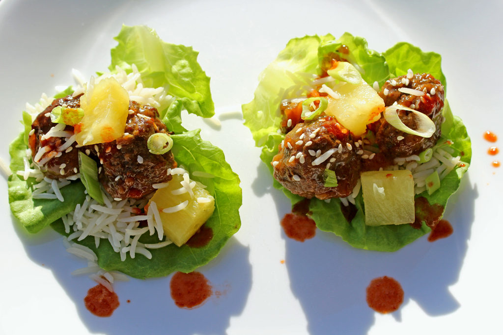 Baked Teriyaki Meatball Lettuce Cups | Tender, juicy meatballs tossed in sweet, tangy teriyaki sauce,placed on Boston lettuce leaves for serving with rice, pineapple, green onion and sriracha. | TheMountainKitchen.com