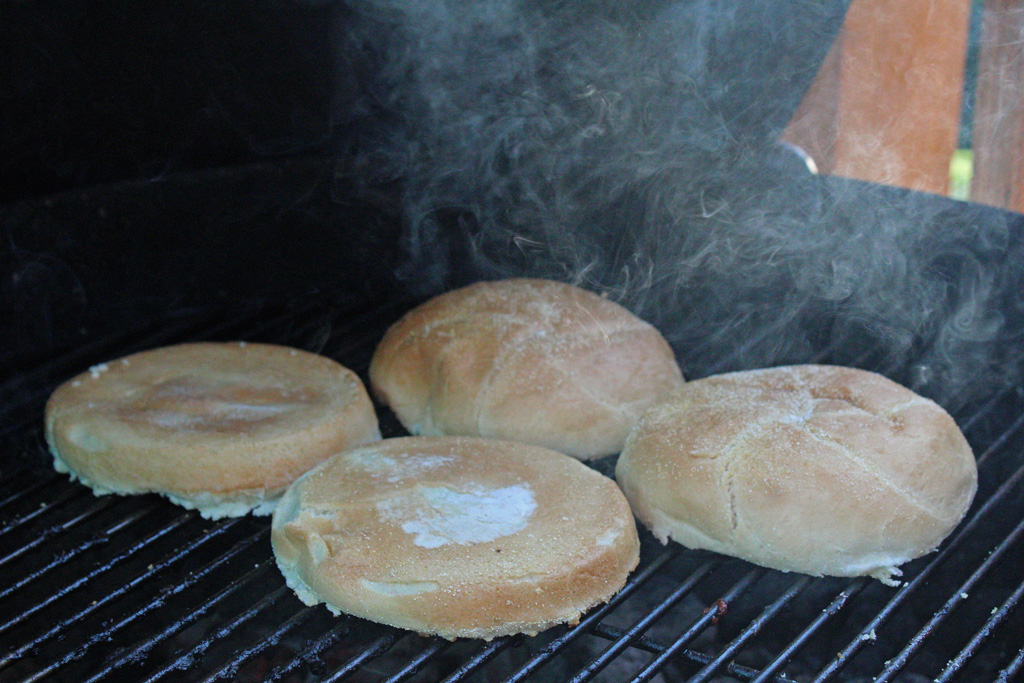 Grilled Teriyaki Chicken Sandwiches with perfectly grilled chicken breasts marinated in a teriyaki sauce made of soy sauce, fresh ginger, garlic and hints of toasted sesame oil on top of a toasted bun with lettuce, tomato and red onions.   TheMountainKitchen.com