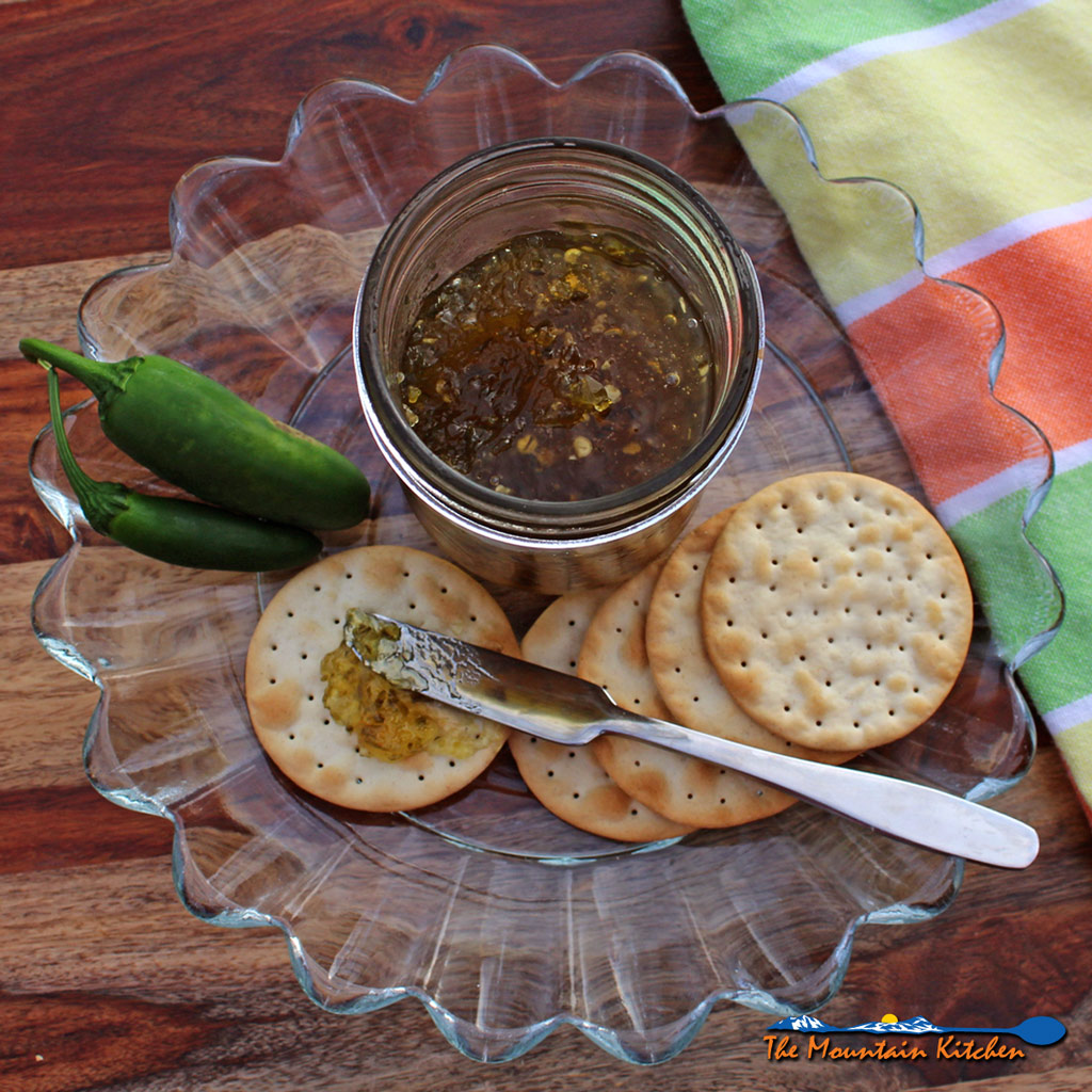 A helpful step-by-step guide on how to make and can jalapeno jelly using water bath canning.