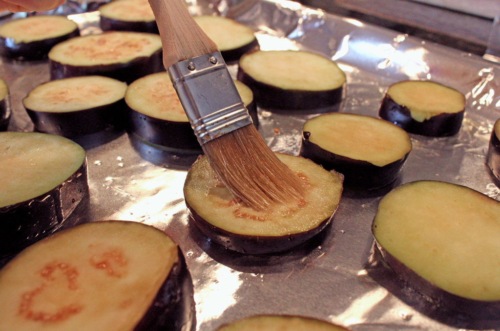 brushing eggplant slices with oil