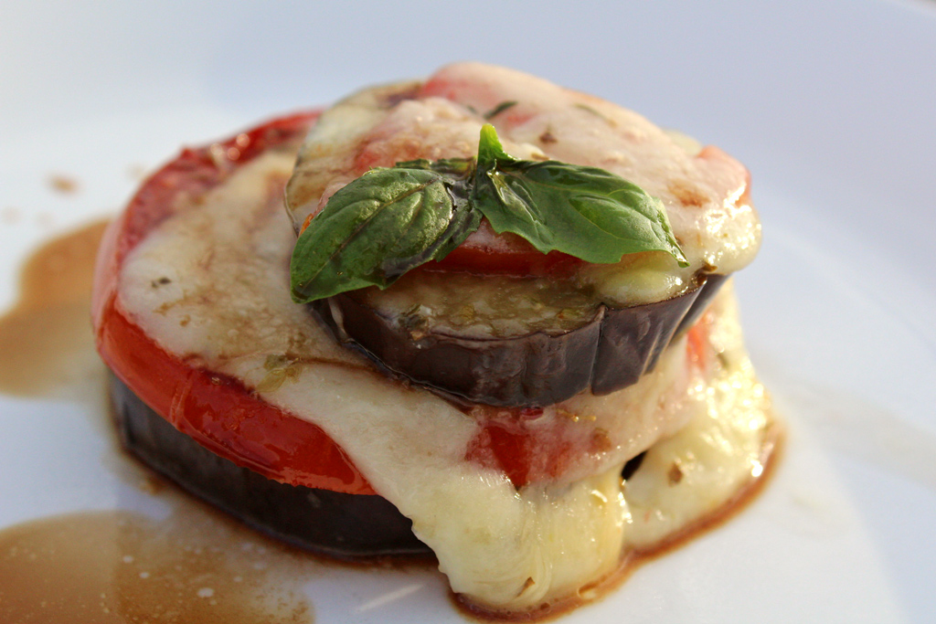 Roasted Eggplant Caprese Stacks are made with fresh basil, melted mozzarella, roasted tomatoes and eggplant slices, drizzled with balsamic vinegar and extra-virgin olive oil. | TheMountainKitchen.com