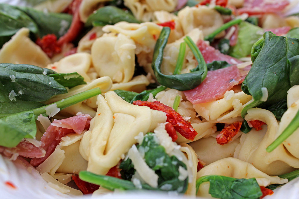 Tuscan tortellini pasta salad tossed together