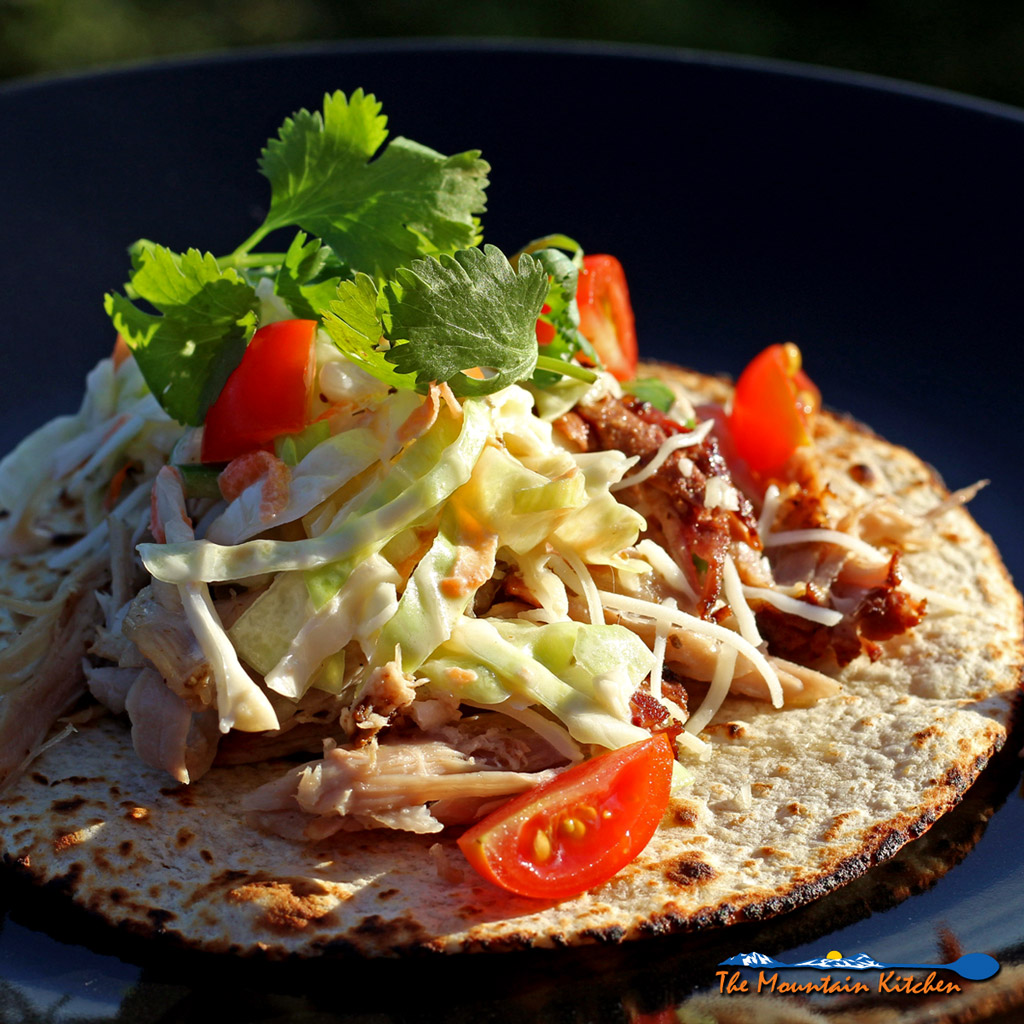Applewood Smoked Pork Carnitas with Spicy Cabbage Slaw, shredded smoky bits of incredibly flavorful pork on top of a warm tortilla with spicy cabbage slaw. | TheMountainKitchen.com