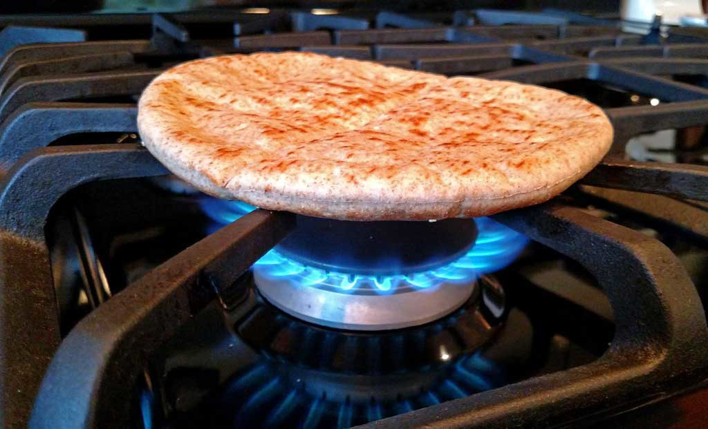 grilling pita bread on gas stove burner
