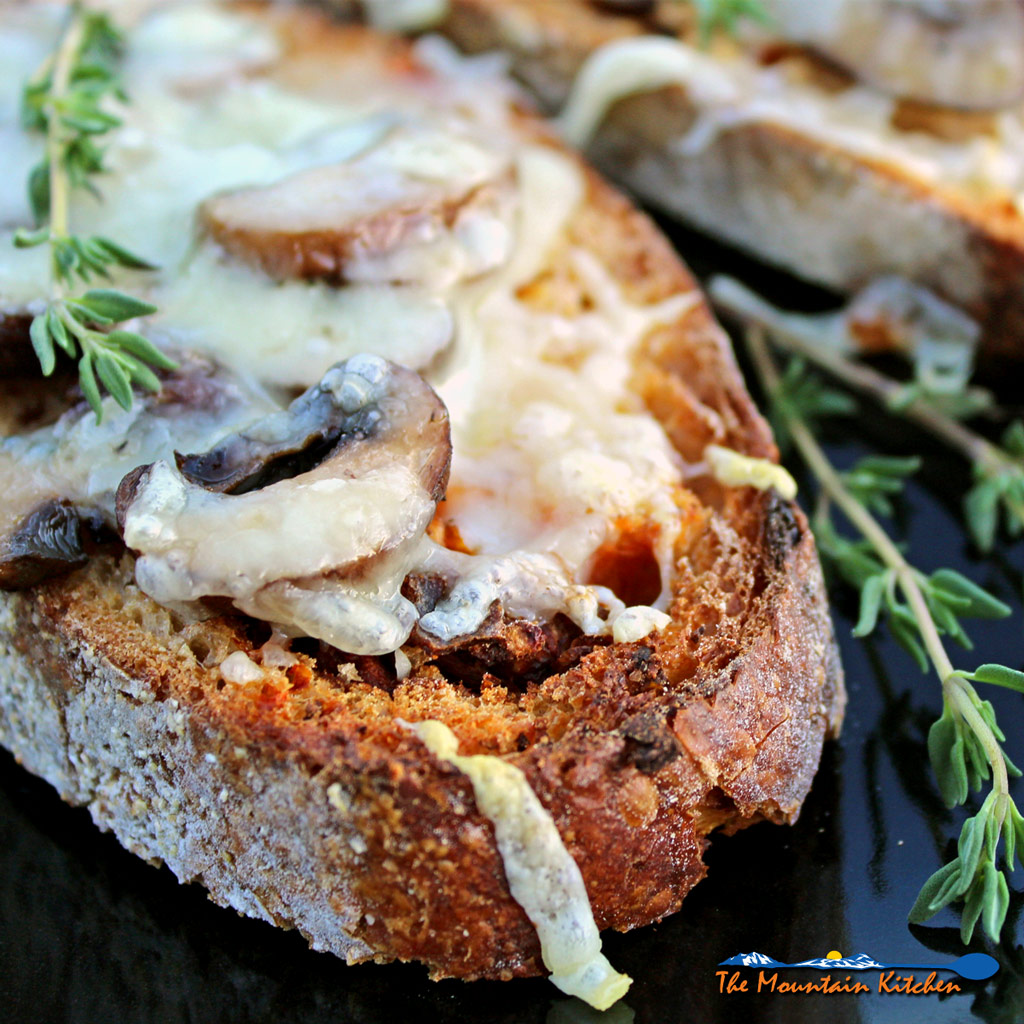 Roasted Mushroom Cheese Toasts, made with crusty rustic bread toasted with garlic and topped with roasted mushrooms, thyme and Gruyere cheese. | TheMountainKitchen.com