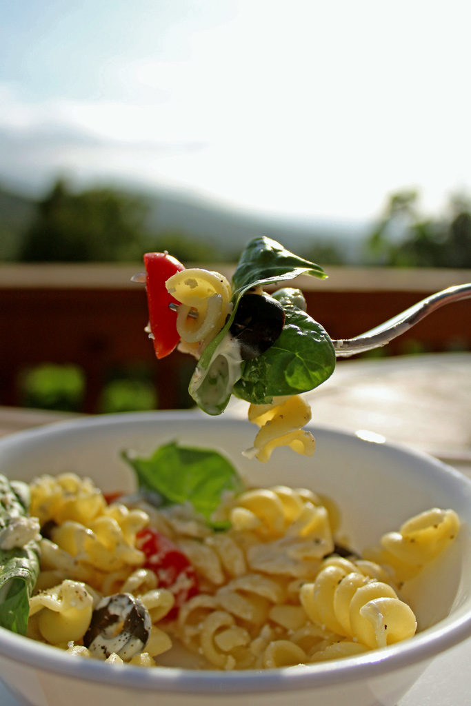 spoonful of salad with mountain view