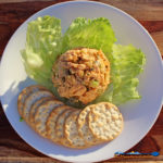 roasted chicken salad on plate with lettuce and crackers