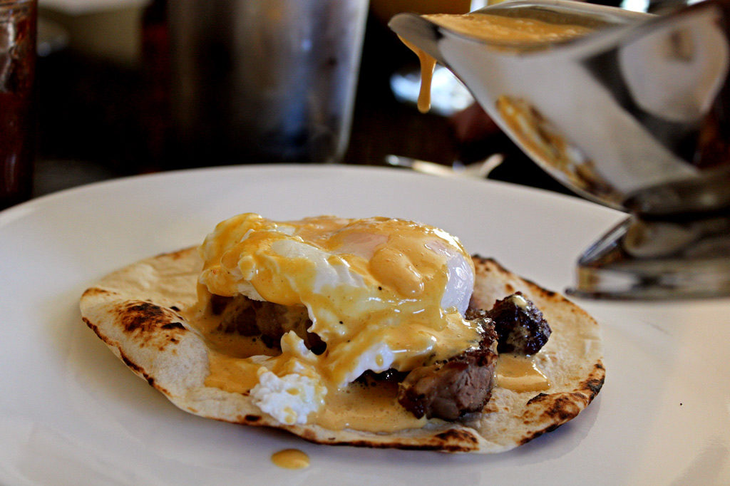 poached egg with Hollandiase sauce on top of steak and tortilla