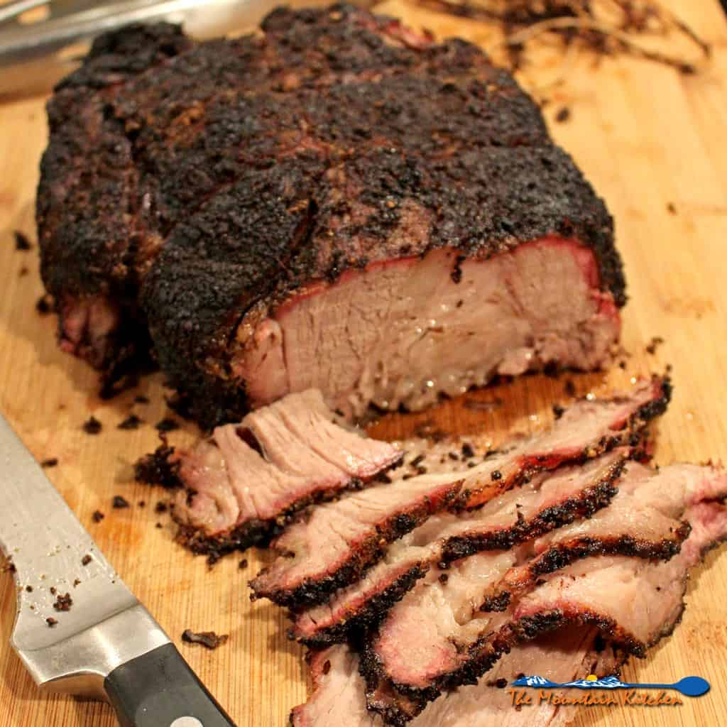 This smoked chuck roast is cheaper than prime rib, easier to get along with than brisket and it is a whole lot easier to come by in the grocery store.