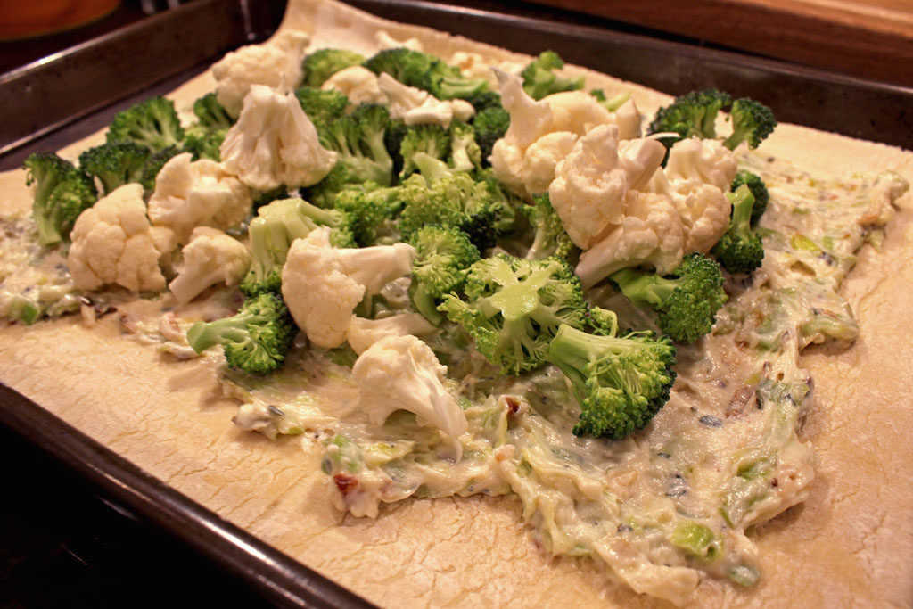 This savory broccoli-cauliflower galette is made with leeks, garlic and ricotta cheese inside a rustic buttery pastry crust.   TheMountainKitchen.com