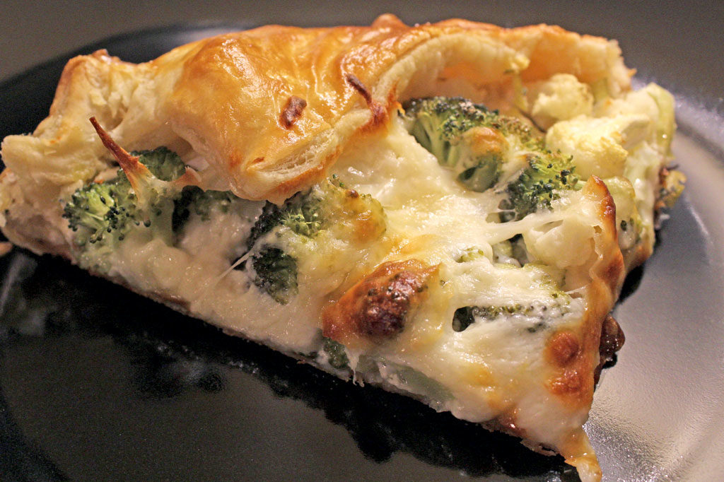 This savory broccoli-cauliflower galette is made with leeks, garlic and ricotta cheese inside a rustic buttery pastry crust. | TheMountainKitchen.com