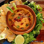 A classic with a twist, this flavorful chipotle-lime hummus is made of chickpeas blended with warm smoky chipotle chilies offset with a zing of lime juice. | TheMountainKitchen.com