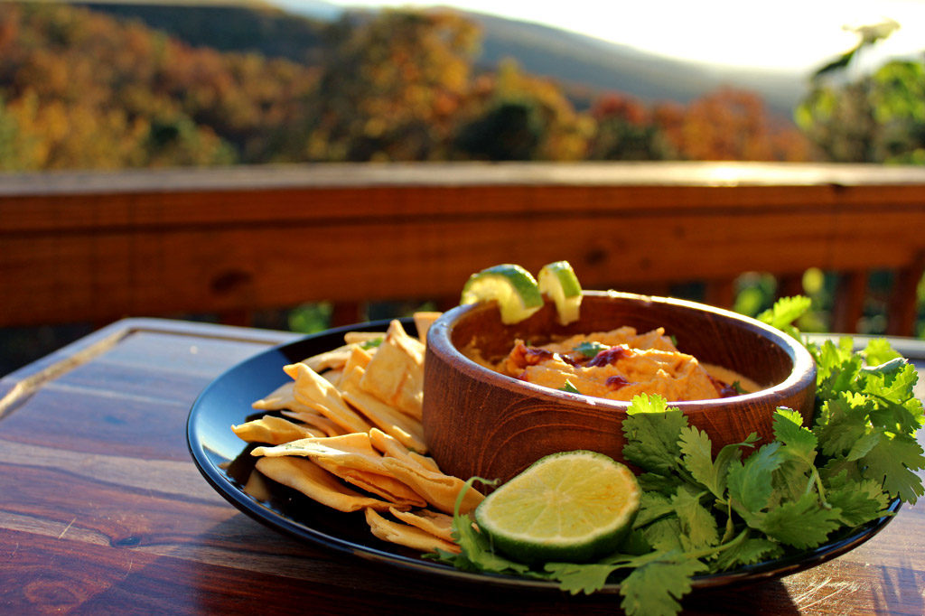 A classic with a twist, this flavorful chipotle-lime hummus is made of chickpeas blended with warm smoky chipotle chilies offset with a zing of lime juice.   TheMountainKitchen.com
