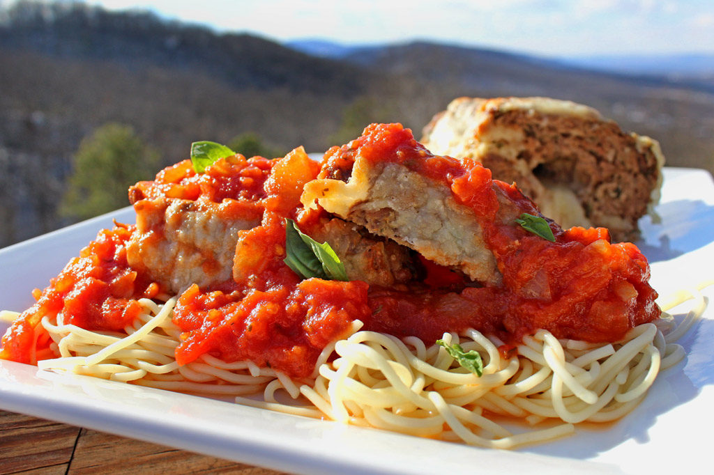 Italian meatloaf on plate with mountain view