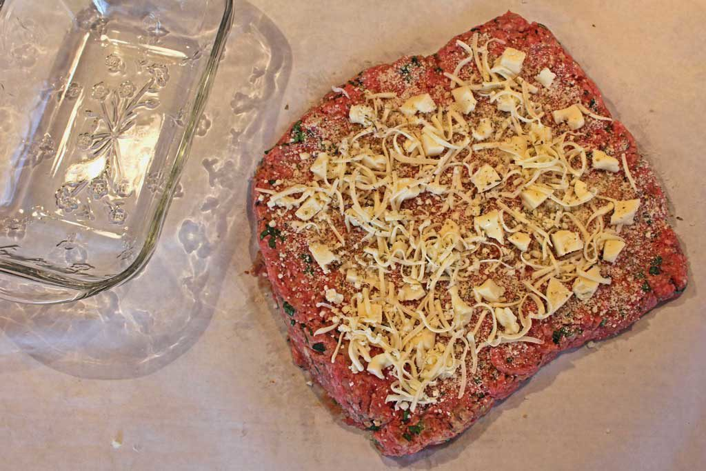 cheese on top of the flattened meat mixture