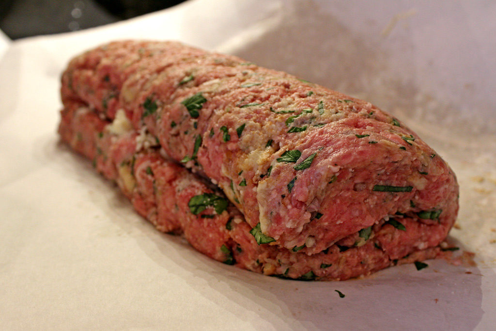 Wow! Take meatloaf to a whole new level, by adding Italian flavors to traditional meatloaf. This tender and delicious Italian Meatloaf is stuffed with cheese and smothered in tomato sauce. | TheMountainKitchen.com