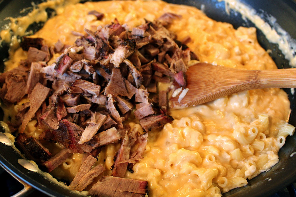 Loaded with big flavor, the smoked beef brisket skillet mac and cheese made with horseradish cheddar and decadently smothered bits of smoked beef brisket. | TheMountainKitchen.com