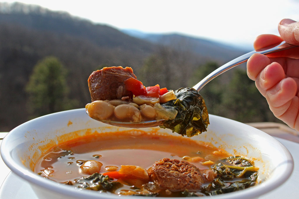 spoonful of Spanish-Style White Bean Soup with mountain view