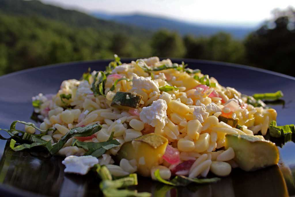 corn zucchini orzo salad with mountain view