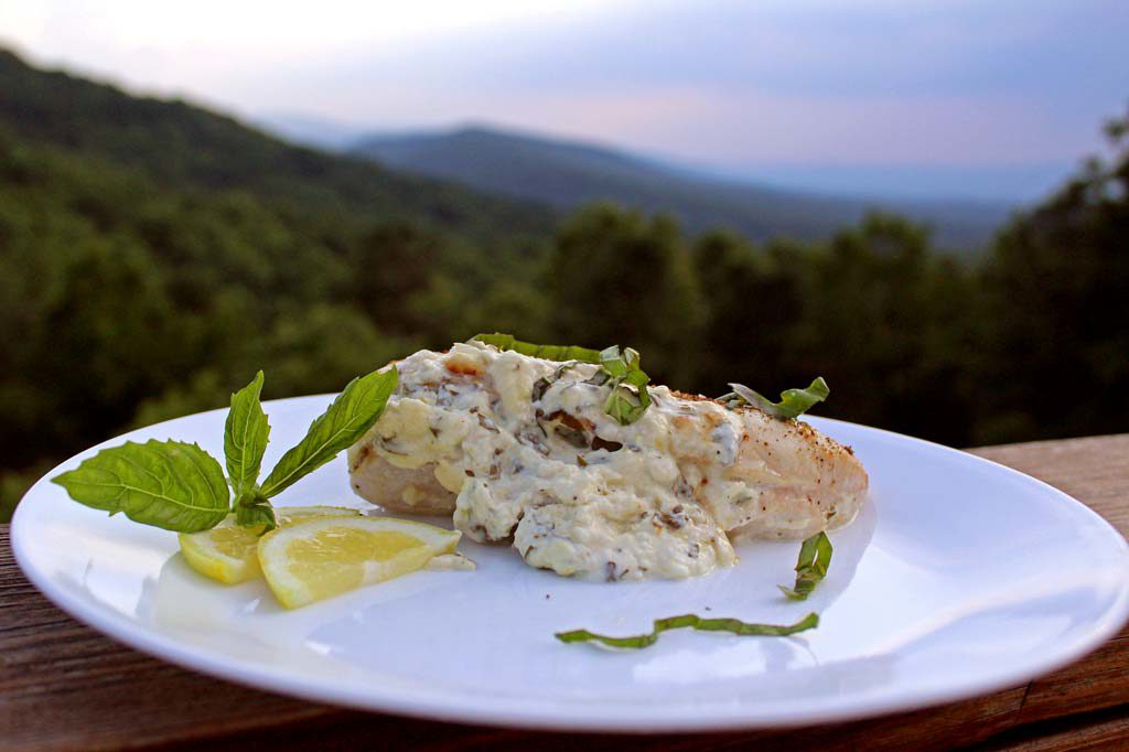 chicken on plate with mountain view