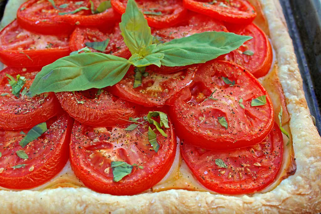 Roasted tomato cheese tart: puff pastry, ripe tomatoes Dijon mustard, smoked Gruyere cheese, simply seasoned with fresh thyme, fresh basil, salt and pepper. | TheMountainKitchen.com
