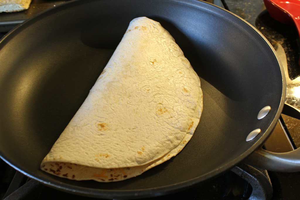 folded quesadilla in pan
