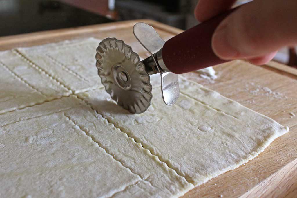 pastry wheel cutting dough